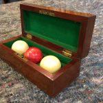 mahogany ball box with ivory billiards balls
