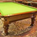 9ft antique snooker table, mahogany with carvings.Thomas Mawson