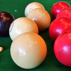 Antique bagatelle balls and original bagatelle marker pegs