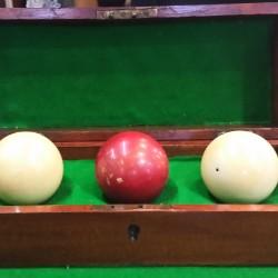 Set of 3 antique ivory billiard balls in original wooden box.