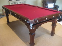 7ft antique Riley snooker diner. Traditionally French polished and re-covered in Cherry Red cloth.
