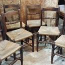 Set of six antique country chairs with rush seats.