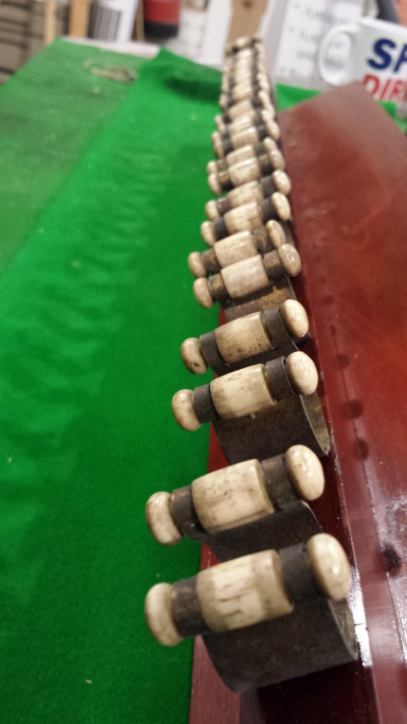 Original cue clips, 12 clip mahogany cue rack.