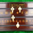 An antique snooker scoreboard in mahogany by Jelks