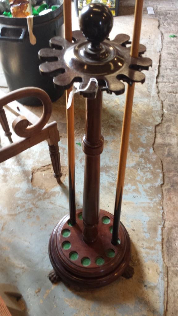Antique cue stand. Mahogany and Bakelite.