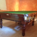 Showing images of our latest antique snooker table installation. This is a 10ft burroughes and Watts antique snooker table. This table has been carefully restored and French polished by hand. We have re-covered using traditional green baize, and installed the table in Provence.