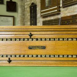 An antique snooker scoreboard by John Taylor & Son, Edinburgh.