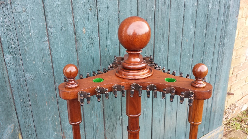 Antique revolving snooker cue stand