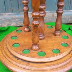 Revolving base, antique oak cue stand.
