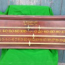 An antique mahogany snooker scoreboard by G Wright.