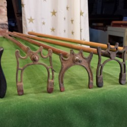 Antique and vintage spider cue rests.