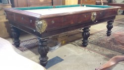 Antique Italian pool table with decorative brass pockets, and iron hands which catch the ball.