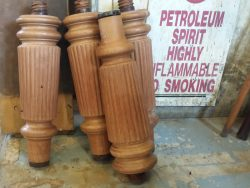 Stripped antique snooker table legs.