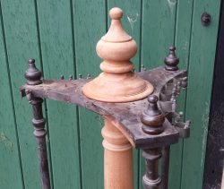 antique revolving cue stand in mahogany