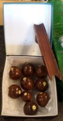 Antique billiard bowls and wooden chute