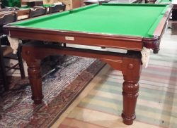 An 8ft antique snooker dining table in mahogany by Riley. Circa 1920.