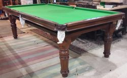 An 8ft antique snooker dining table in mahogany by Riley. Circa 1920. B742