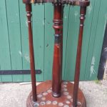 A Victorian revolving cue stand in mahogany by Orme.