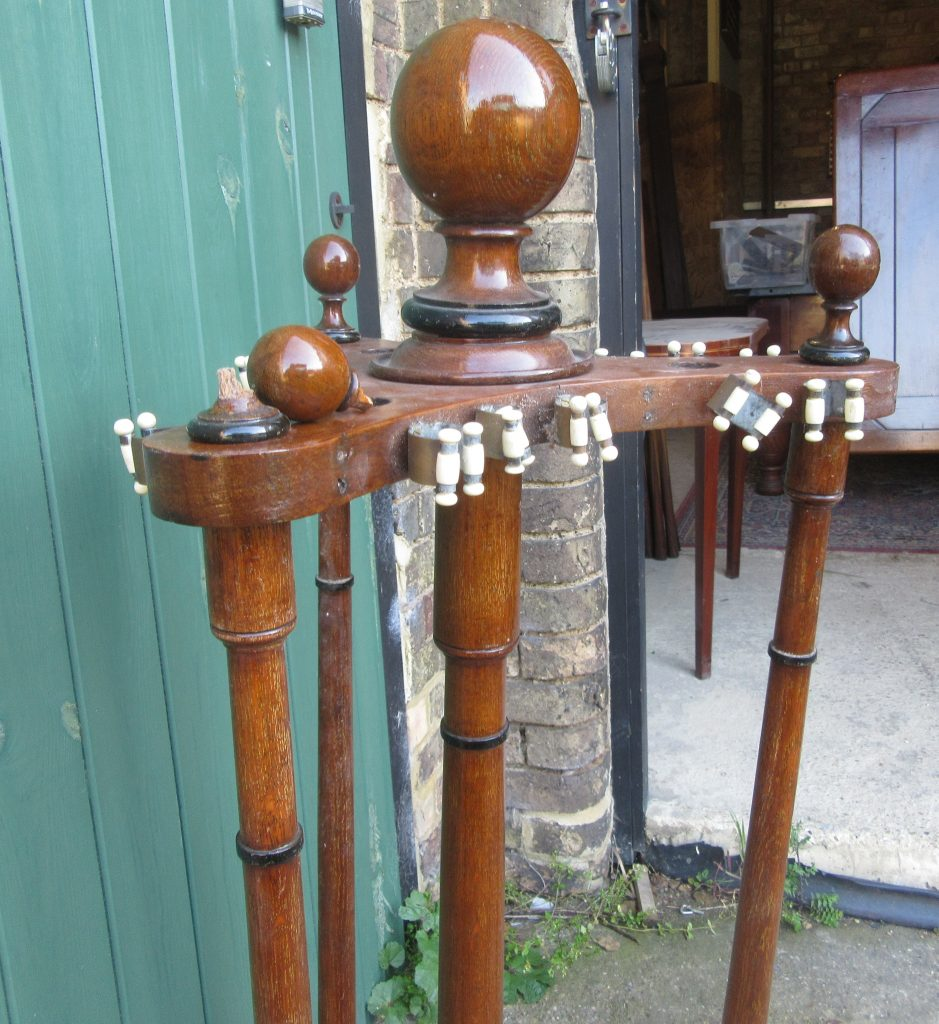 Antique revolving cue stand