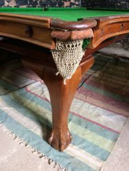 Ball and claw foot on Riley antique snooker dining table.