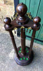 Antique oak revolving cue stand
