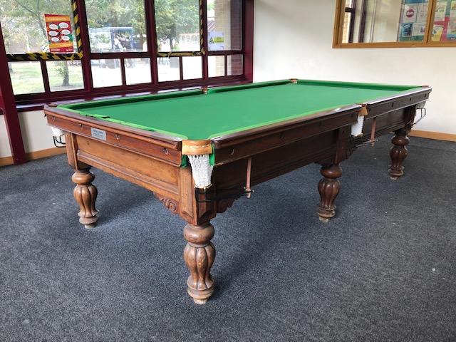 Antique billiards table