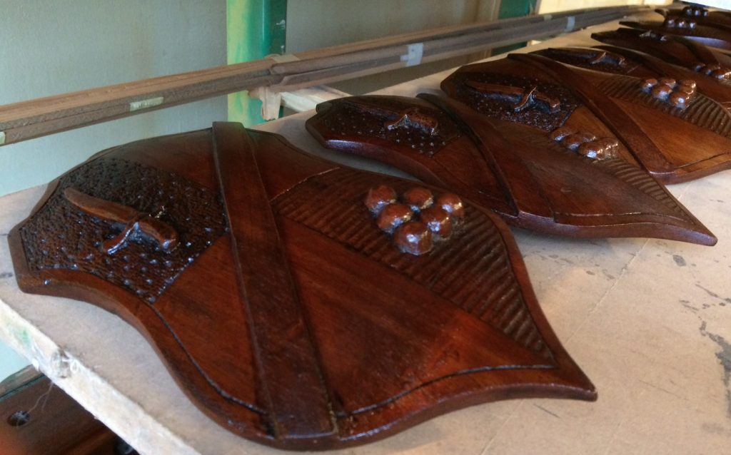 French polishing the decorative shields from 9ft Spencer snooker / billiards table